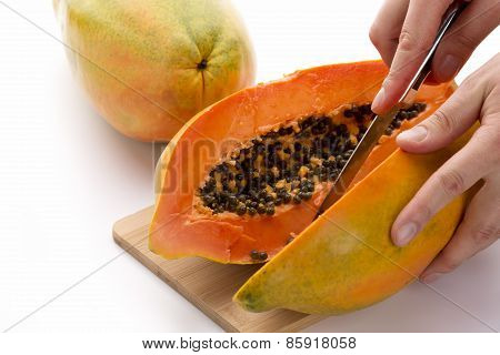 Papaya Cut In Half Along Its Longitudinal Axis