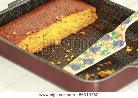 Piece of pumpkin cake at baking tray