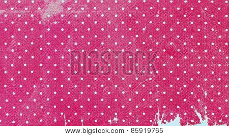 Old yellowed polka dots fabric close up, background