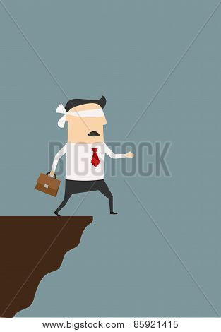 Blindfolded businessman about to fall from cliff