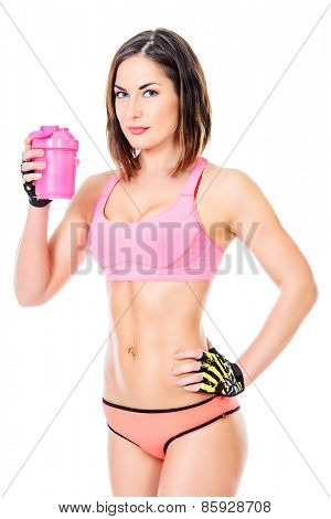 Sporty young woman drinking water after training. Active lifestyle, wellness. Isolated over white.