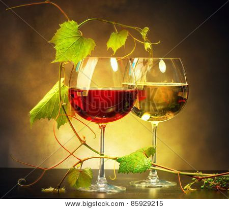 Wine. Two Glasses of wine. Glass of red and white wine decorated with grape leaves. Vine leaf. Sepia toned art design