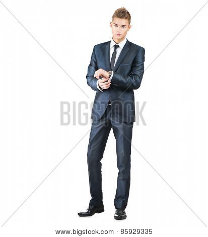 Full length portrait on young handsome man. Elegant businessman in suit isolated on a white background