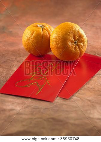 concept image of the chinese new year -mandarin orange and red packet