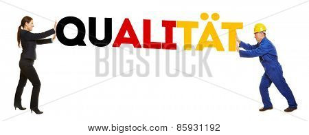 People pushing the German word Qualitaet (Quality) in German national colors