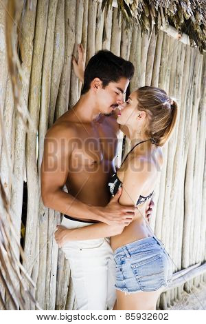 Sensual couple in a tropical beach