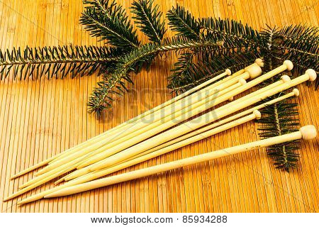 Knitting Needles And Yew Branch
