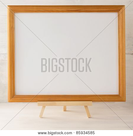 picture frame on wooden background