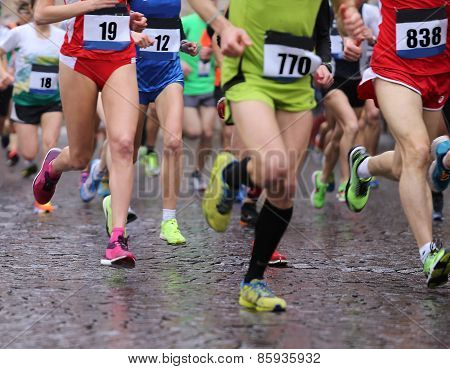 Athletes Runs During The Rainy Marathon