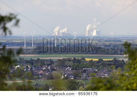Distant Power Stations Framed By Trees