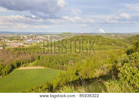 Distant Power Station In Green Landscape