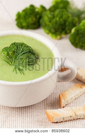 Delicious green broccoli soup traditional recipe in a white bowl