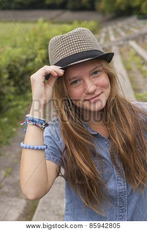 Teenage girl posing in a Park in front of the camera.