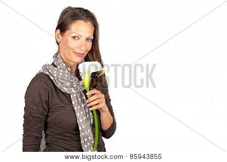 Beautiful mature woman with a  blossoming cala flower