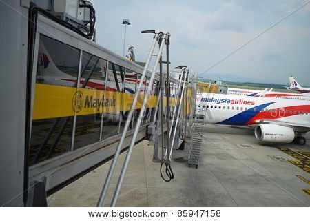 KUALA LUMPUR, MALAYSIA - MAY 12, 2014: docked jet aircraft. Kuala Lumpur International Airport (KLIA) is Malaysia's main international airport and one of the major airports of South East Asia