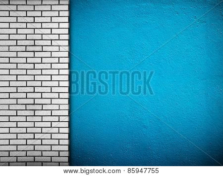 blue wall with brick background