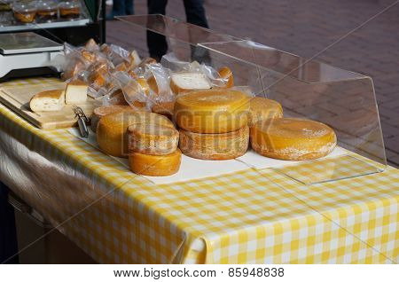 cheese stall at an open-air farmers market