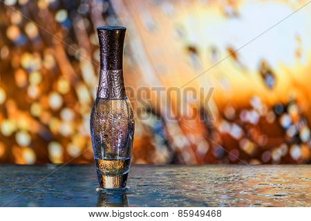 Perfume Bottle Under The Rain