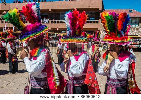 Puno, Peru - July 25, 2013: musicians and dancers in the peruvian Andes at Taquile Island on Puno Peru at july 25th, 2013.