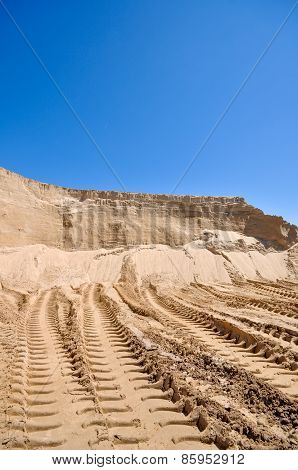 Sand Pit With Traces Of Tractor
