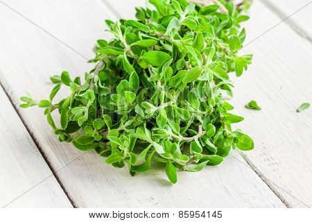 Bunch Of Raw Green Herb Marjoram On A White  Wooden Table