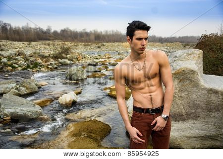 Athletic Shirtless Young Man Outdoor At River Or Water Stream