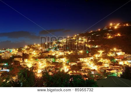 Virgin Islands St Thomas mountain view in early morning with buildings.