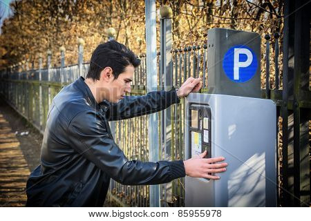 Young Man Waiting For A Parking Ticket