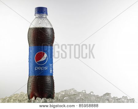 Kuala Lumpur-Malaysia,March 23,2015 bottle of Pepsi cola. Pepsi is a carbonated soft drink that is produced and manufactured by PepsiCo