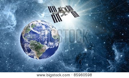 Space Station Over Blue Planet Earth In Space.