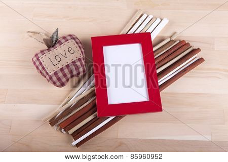 Beautiful composition with photo frames and wooden sticks.