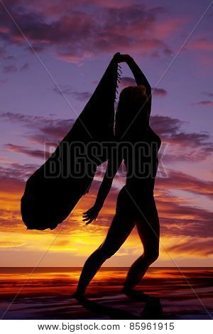 Silhouette Of A Woman With A Sarong Blowing Hand Back