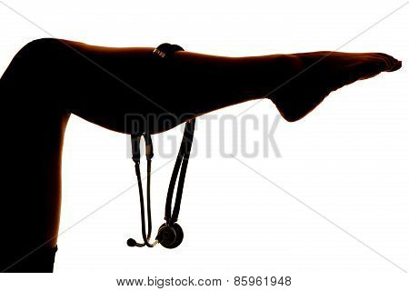 Silhouette Of Stethoscope On Womans Leg