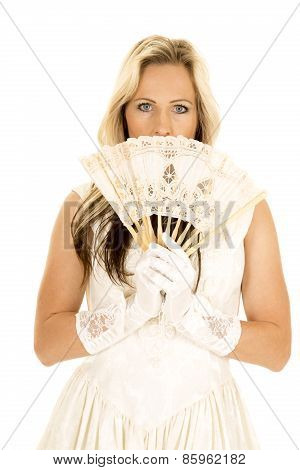 Woman In A White Dress With A Fan In Front Of Face Looking