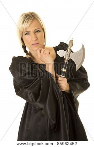 Woman In Black Cloak Hatchet Hand By Chin