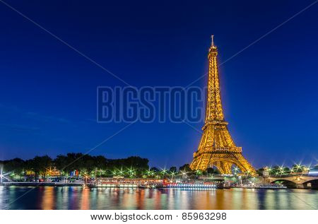 PARIS - JULY 12, 2013: Eiffel Tower on July 12, 2013 in Paris. Eiffel tower is one the most popular attractions in Paris