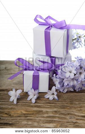 Gift Boxes With Bows And Blue Hyacinth