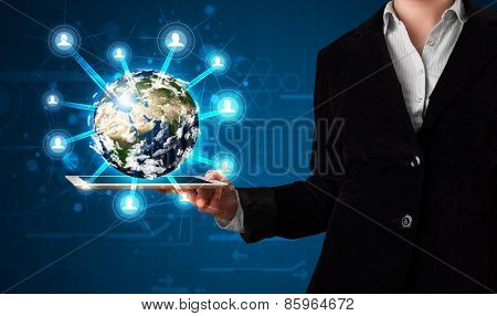 Young woman presenting 3d earth globe in modern tablet