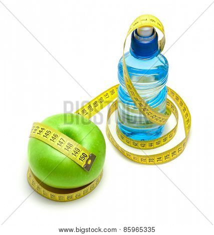 Green apple and bottle with water
