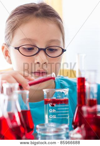 Little girl with laboratory glassware