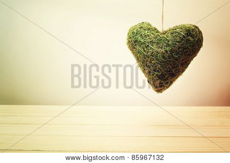 Rustic Green Moss Heart In A Gradient Beige Wall Background
