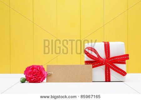 Blank Tag With Carnation Flower And Gift Box On Sides
