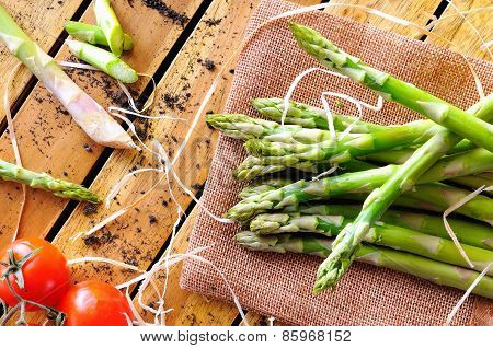 Asparagus With Tomatoes On A Table Top View