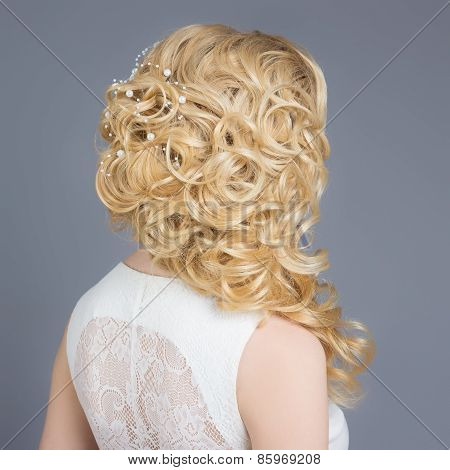 beautiful young girl in the image of the bride, beautiful wedding hairstyle with flowers in her hair