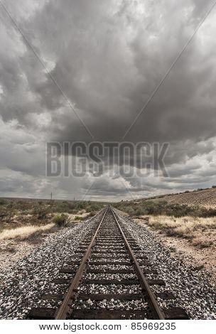 Single Railroad Track In Desert