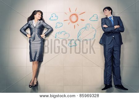 Funny businessman and woman lying on floor. Competition concept