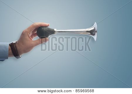 Businessman Playing An Air Horn