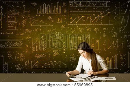 Businesswoman sitting at black table with hand drawn diagram background