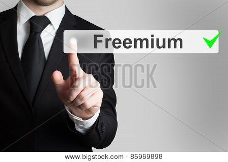 Businessman Pushing Flat Button Freemium Green Checked