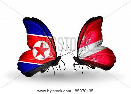 Two Butterflies With Flags On Wings As Symbol Of Relations North Korea And Latvia